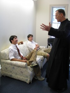 Visiting monk Curtis Almquist visits with Holy Cross teenagers.