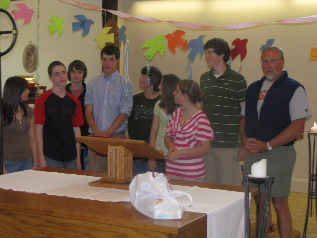 Some of the Youth Group members helped decorate the Worship Space with paper doves for the Day of Pentecost.