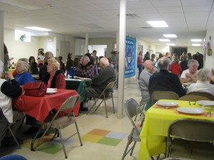 Weare seniors enjoy a holiday meal served by the Girl Scouts in the Parish Hall.