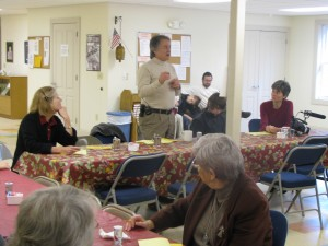 Caroline Fairless (left) listens as Jim Sims talks about their ministry over Sunday morning breakfast.