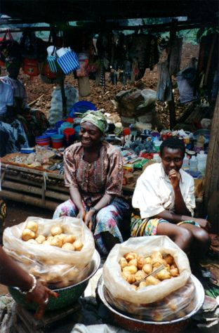 KWIHEED supports microentrepreneurs like this woman, selling produce in the marketplace.