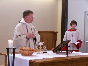 Fr. John presides at the Altar during the Great Thanksgiving.
