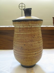 Otto Heino's ashes rest in a burial urn that he made, wood-fired with his famous yellow glaze.