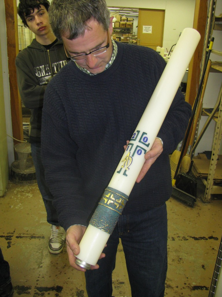 Martin Marklin displays one of his company's hand-crafted Paschal candles.