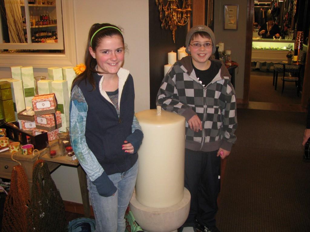 "Tammi and Garrick pose beside ""Big Bertha,"" the fattest candle Marklin makes."