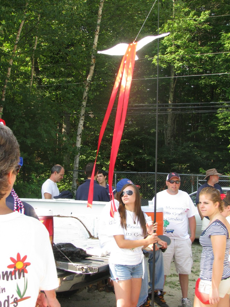 Brianna was in charge of the pole flying the Holy Spirit dove at the head of the line.