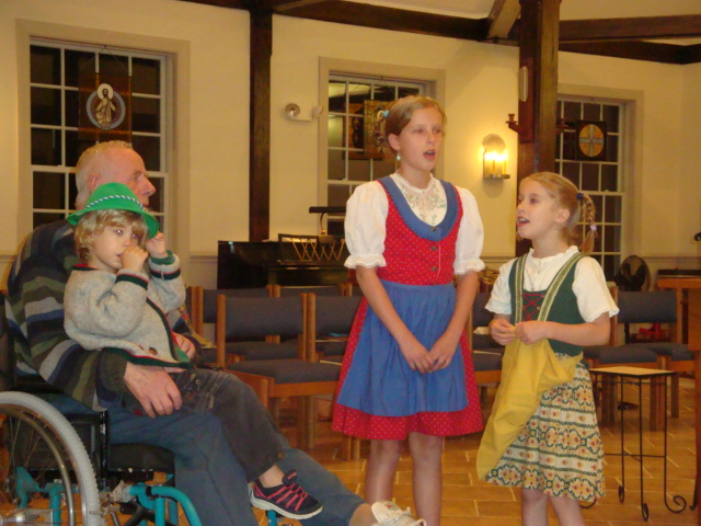 The Douzanis children, dressed in Tyrolean costume, sang some German songs with their grandfather.