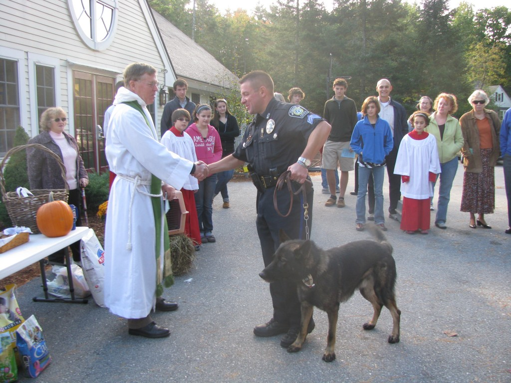 Officer Kelly and the new Weare K9 dog were a special hit at the blessing. The dog, presently just designated 26, showed a special interest in Tom Beland's rabbits. So criminal bunnies better watch out around Weare!